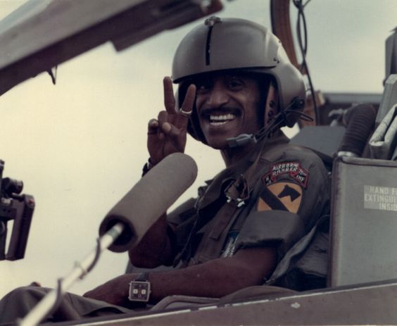Sammy Davis Jr. in the cockpit of a helicopter